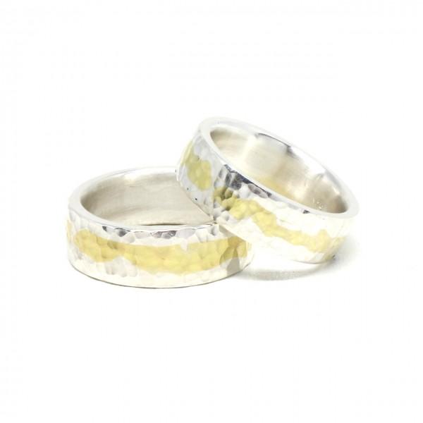 Trauringe Handarbeit in Silber mit 750 Gelbgold